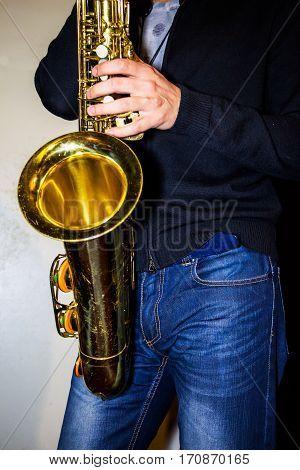 Man plays a tenor sax Golden color
