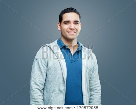 young handsome smiling man, isolated against gray background