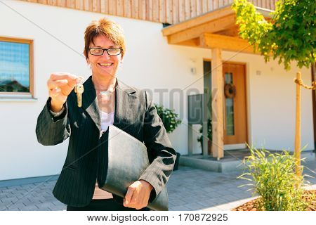 realtor giving you the key to your new home