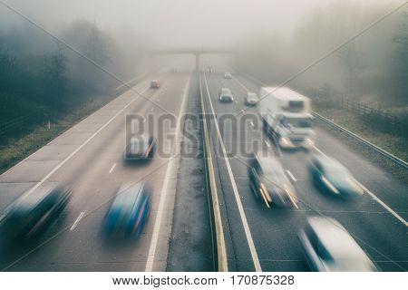 Cars on Dual Lane Motorway in Heavy Fog
