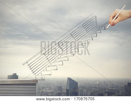 Hand drawing a rising scale. Concept of career of a businessman