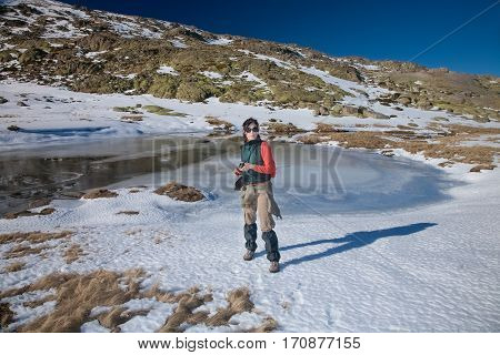 Hiker Woman Standing In Winter Snow