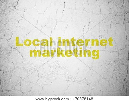 Advertising concept: Yellow Local Internet Marketing on textured concrete wall background