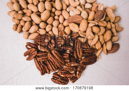Nuts mixed for backgrounds or textures on white