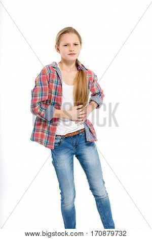 young teenage girl holding stomach with ache on white background