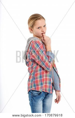 Portrait of young cute shy teenage girl on white background