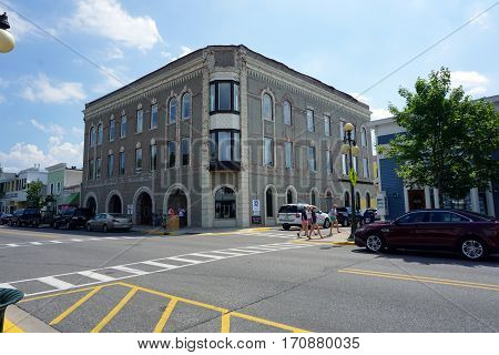 HARBOR SPRINGS, MICHIGAN / UNITED STATES - AUGUST 4, 2016: The historic First Community Bank building, at the corner of Main and Spring Streets, in downtown Harbor Springs.