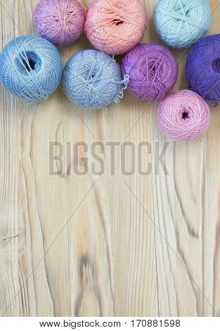Bright multicolor balls of cotton yarn for knitting crochet and creative craft work. Place for text. Selective soft focus