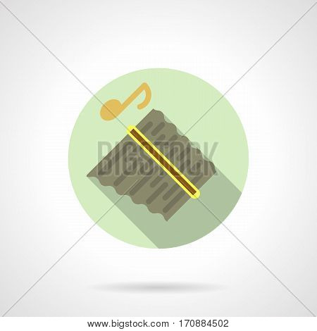 Symbol of abstract panpipes or pan flute with golden note, long shadow design. Tribal wind musical instruments. Stylish round flat color vector icon.