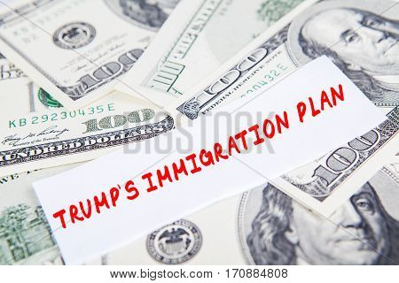 Image of dollars currency with text of Trump's Immigration Plan symbolizing Trump Effect in American economy