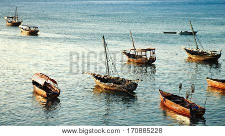 zanzibar, a group of boats during the sunset