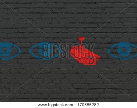 Protection concept: row of Painted blue eye icons around red cctv camera icon on Black Brick wall background