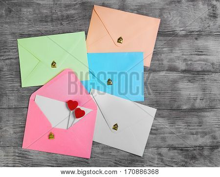 Valentines Day Envelope Mail Red Heart. Valentine Letter Card Wedding Love Concept in colorful letters envelopes. Gold seal with hearts valentine envelopes. Vintage white wood background. Top view