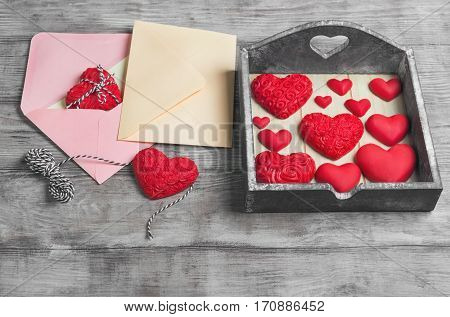 Card to Valentine's Day. Paper for text congratulations letter. Heart from red marzipan in box. Heart with pattern and heart sleek white wooden background. Space place.