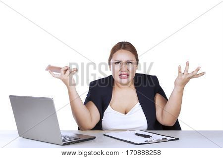 Businesswoman shrugs her shoulder as her doubt expression isolated on white background