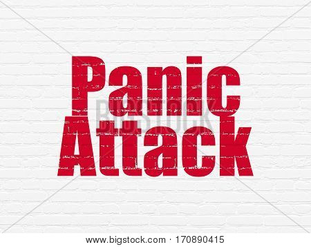 Health concept: Painted red text Panic Attack on White Brick wall background