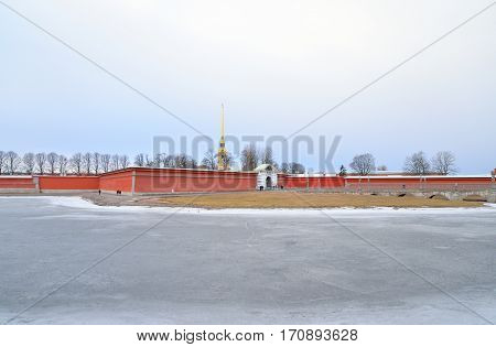 Frozen River Neva and bastion of Peter and Paul Fortress in St.Petersburg, Russia.