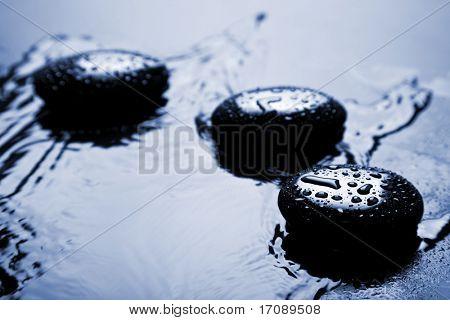shiny zen stones with water drops