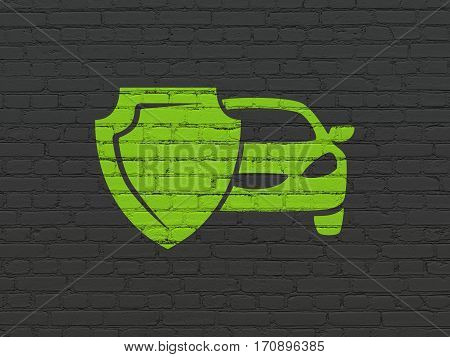 Insurance concept: Painted green Car And Shield icon on Black Brick wall background