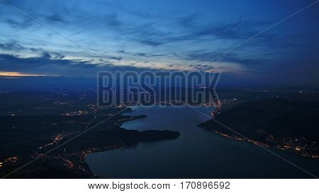 Lake Zugersee and Zug by night view from mount Rigi.