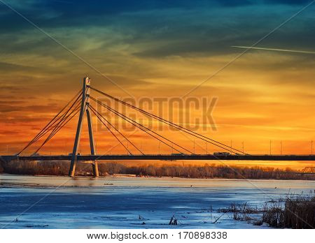Moskovskyi (Moscow) bridge over stunning sunset in Kiev Ukraine
