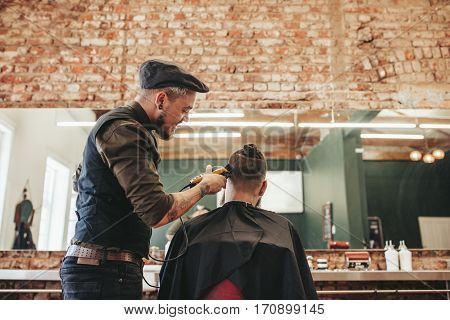Hairdresser Cutting Hair Of Client
