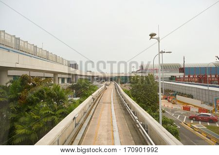 SINGAPORE - CIRCA NOVEMBER, 2015: view from Changi Airport Skytrain. The Changi Airport Skytrain is an automated people mover that connects Terminals 1, 2 and 3 at Singapore Changi Airport.