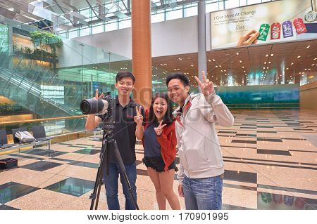 SINGAPORE - CIRCA NOVEMBER, 2015: indoor portrait of people at Singapore Changi Airport Terminal 3. Changi Airport, is the primary civilian airport for Singapore.