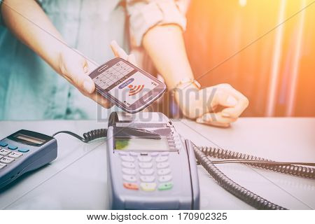 mobile payment phone retail nfc pay paying smart shopping reader woman wireless concept - stock image