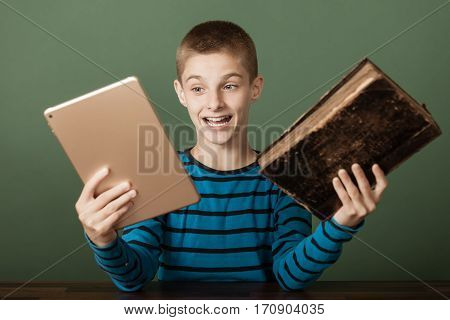 Excited Boy Comparing Two Books
