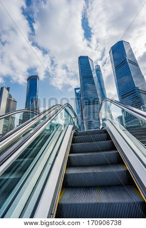 Escalator with cityscape in background of China.