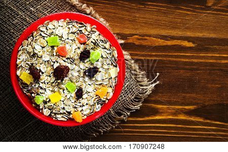 Muesli With  Dried Fruit (strawberries, Grapes, Kiwi, Peach). Muesli On A Wooden Table. Muesli Top V