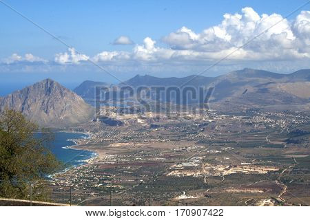 Aerial view of the towns, ocean and mountains below from the ancient town of Erice, Sicily, Italy