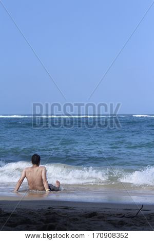 Man looking at the sea on a summer day