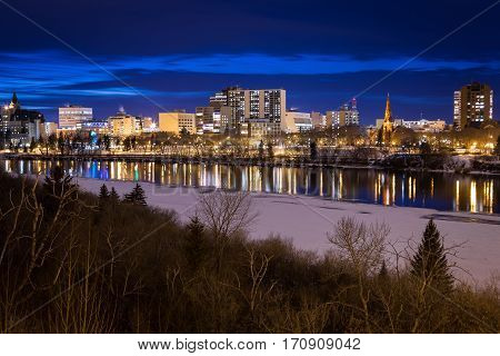 View of the waterfront of downtown Saskatoon at night.