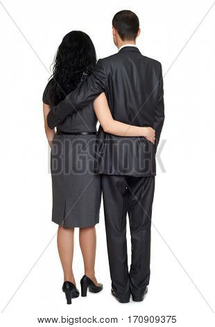 couple rear view, people backside dressed in black classic suit, full length on white background