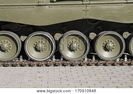Heavy Military tank, detail of tracks or wheels of the off-road armored vehicle