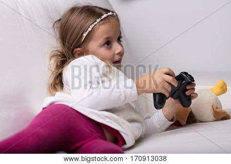 Little Girl Playing With A Video Game Controller