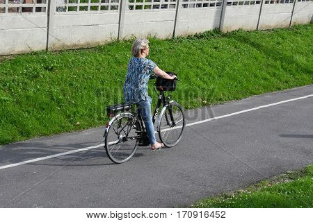 La Neuville Chant d Oisel France - june 22 2016 : woman on a bicycle lane