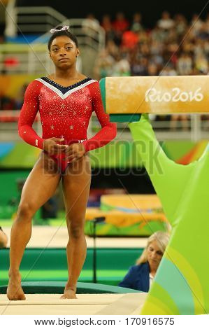 RIO DE JANEIRO, BRAZIL - AUGUST 15, 2016: Olympic champion Simone Biles of United States before final competition on the balance beam women's artistic gymnastics at Rio 2016 Olympic Games