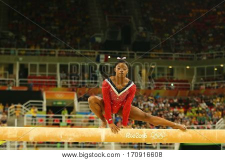 RIO DE JANEIRO, BRAZIL AUGUST 15, 2016: Olympic champion Simone Biles of United States competes at the final on the balance beam women's artistic gymnastics at Rio 2016 Olympic Games