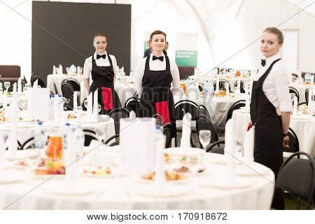 group of waiters at a prestigious restaurant served tables to the Banquet