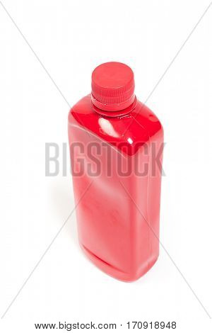 Red plastic bottle isolated on white background