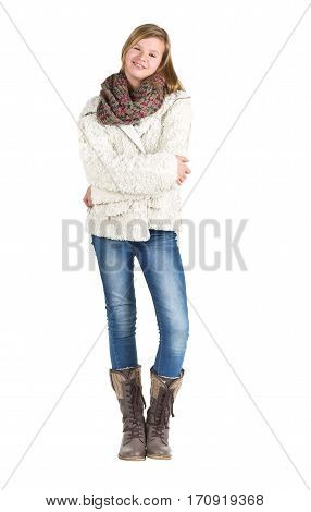 Young girl with blue jeans winter jacket and boots standing posing over white background