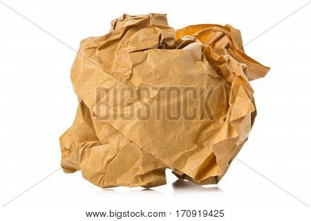 Crumbled brown recycled paper ball on white background - waste or fail concept