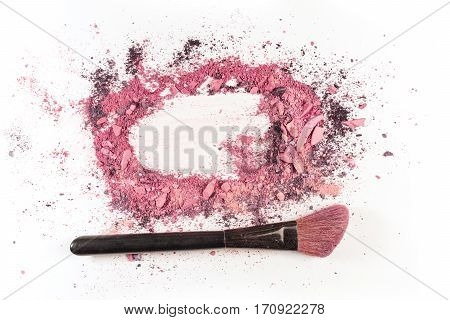Traces of vibrant pink powder and blush forming a frame, with a makeup brush. A horizontal template for a makeup artist's business card or flyer design, with copy space