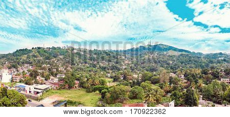 Landscape with hills and town in Sri Lanka in winter
