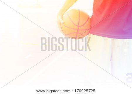 Close up playeer with basketball ball in gym