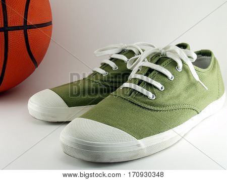 green sneakers with basketball on white background, footwear and sports equipment for fitness