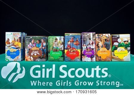 Alameda CA - February 12 2017: Traditional Girl Scout cookie booth with Little Brownie Baker brand cookies with a black background. Cookie sales raise funds for troop lead events and activities.
